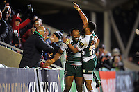 Vereniki Goneva of Leicester Tigers is congratulated by team-mate Telusa Veainu after scoring a second half try. European Rugby Champions Cup match, between Leicester Tigers and Munster Rugby on December 20, 2015 at Welford Road in Leicester, England. Photo by: Patrick Khachfe / JMP