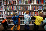 Students select their books from the Elko County Bookmobile during a recent visit to the one-room schoolhouse in Ruby Valley. <br />
