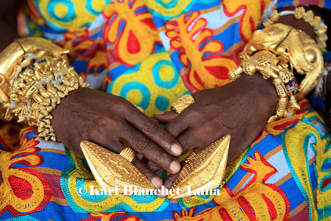 The hands of the chief of Nkoranza covered with golden rings and bracelets. The Chief of NKoranza spent twenty years of his life in Edgware road, London, until the family asked him to come back to Ghana to become king.