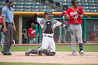 Jett Bandy (27) of the Salt Lake Bees on defense against the Tacoma Rainiers in Pacific Coast League action at Smith's Ballpark on May 7, 2015 in Salt Lake City, Utah. The Bees defeated the Rainiers 11-4 in the completion of the game that was suspended due to weather on May 6, 2015. (Stephen Smith/Four Seam Images)