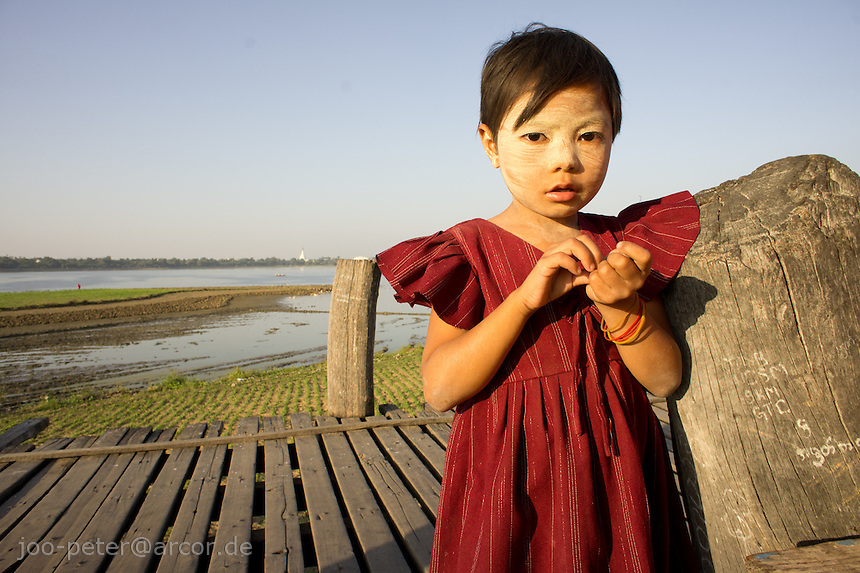 girl on U Bein's bridge,  Amarapura, Mandalay, Myanmar, 2011
