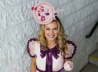 LOUISVILLE, KY - MAY 05: A woman poses for a photo wearing a fascinator on Kentucky Oaks Day at Churchill Downs on May 5, 2017 in Louisville, Kentucky. (Photo by Jesse Caris/Eclipse Sportswire/Getty Images)