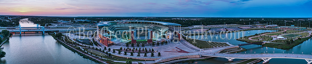 This is a 180 degree aerail panorama of the McLain stadium after dark with just a hint of color still left in the sky after a spectacular sunset. This aerial view point gives you a nice view of the area around the stadium from the pedestrian bridge to the IH35 stay bridge with the blue lights on all the way down the brazos river with it many old iron bridges still in use.