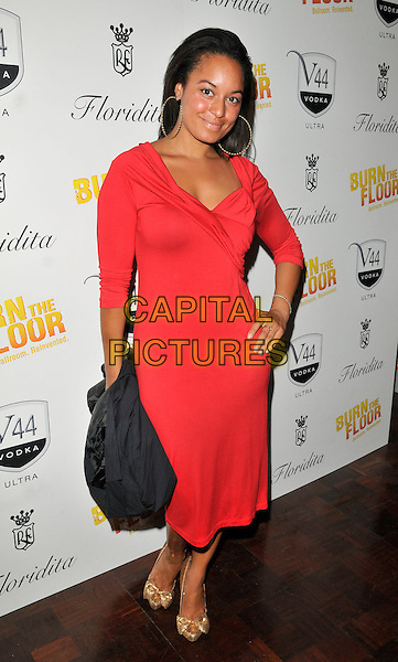 RHEA BAILEY.'Burn  the Floor' Press Night at the Shaftesbury Theatre, London, England..July 26th 2010.full length red dress hand on hip .CAP/CAN.©Can Nguyen/Capital Pictures.