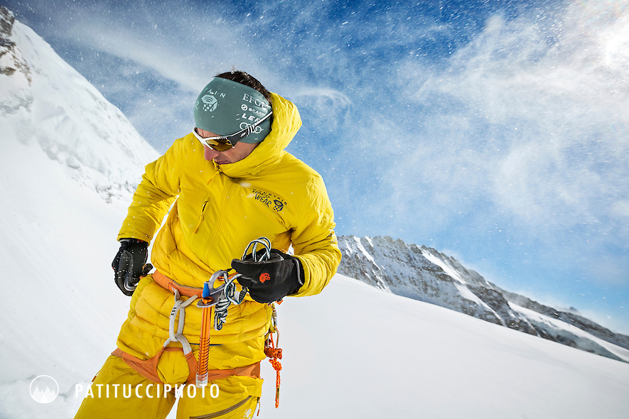 Ueli Steck getting his gear and clothing organized near the Jungfraujoch and the base of the Mönch, befor a climbing training day, Switzerland.