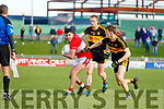 Mikey Geaney Dingle in action against Colm Cooper and Gavin White of Dr. Crokes during the Kerry County Senior Club Football Championship Final match between Dr Crokes and Dingle at Austin Stack Park in Tralee, Kerry on Sunday.