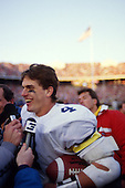 Michigan Wolverines quarterback Jim Harbaugh celebrates a 26-24 victory over the Ohio State Buckeyes at Ohio Stadium in Columbus, Ohio on 11/22/86. Harbaugh was named as the 20th Head Football coach at the University of Michigan on Dec. 30, 2014. Photo by John D. Hanlon, 25-year photographer for Sports Illustrated.