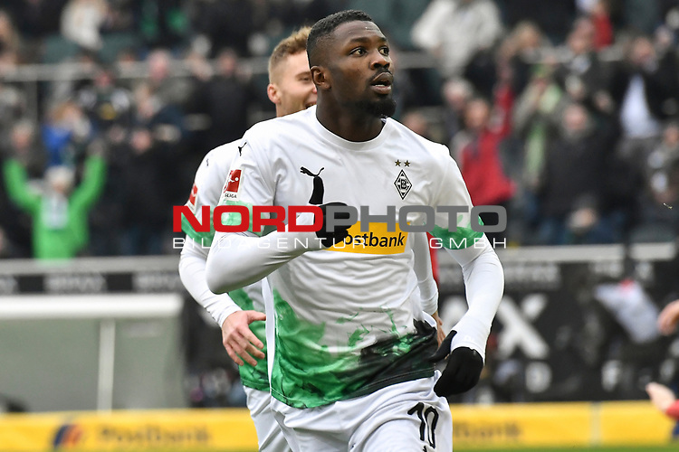 01.12.2019, Borussia-Park - Stadion, Moenchengladbach, GER, DFL, 1. BL, Borussia Moenchengladbach vs. SC Freiburg, DFL regulations prohibit any use of photographs as image sequences and/or quasi-video<br /> <br /> im Bild Marcus Thuram  (#10, Borussia Moenchengladbach) jubelt nach seinem Tor zum 1:0<br /> <br /> Foto © nordphoto/Mauelshagen