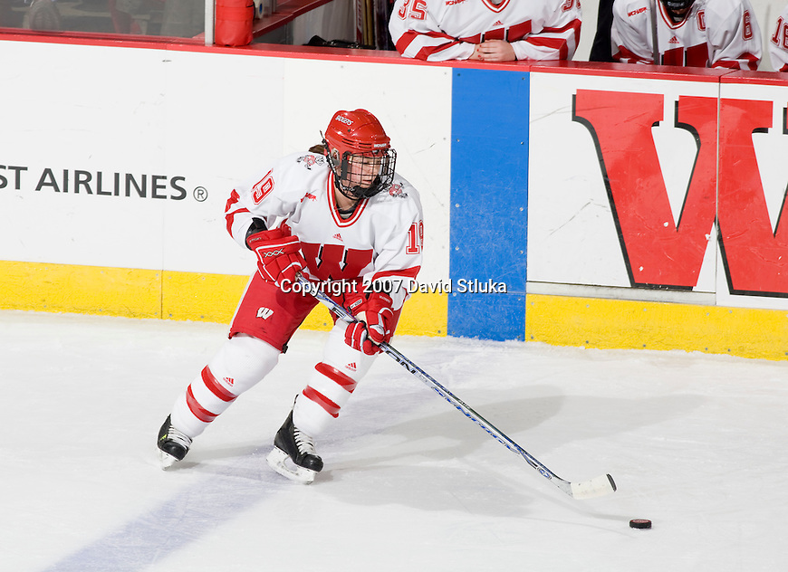 MADISON, WI - DECEMBER 1: Alycia Matthews #19 of the Wisconsin Badgers women's hockey team handles the puck against the Minnesota Duluth Bulldogs at the Kohl Center on December 1, 2007, in Madison, Wisconsin. The Bulldogs beat the Badgers 3-2. (Photo by David Stluka)