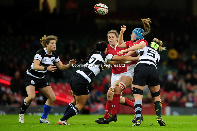 Gwen Crabb of Wales is tackled by Rebecca Clough of Barbarians during the International friendly match between Wales and Barbarians at the Principality Stadium in Cardiff, Wales, UK. Saturday 30 November 2019