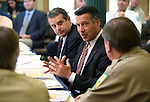 Nevada Gov. Brian Sandoval, center, talks with state fire officials during a briefing at the Capitol in Carson City, Nev., on Monday, May 4, 2015. Extreme drought conditions have agencies preparing for the high danger of wildland fires. <br /> Photo by Cathleen Allison