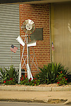 Metal windmill man at entrance to Dempster Industries building, Beatrice, Neb.