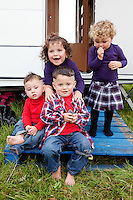 2/10/2010.  Taveler's  Fono 2, Michael 3, Maggie 2 and Eileen Stokes aged 1 from Galway are pictured at the Ballinasloe Horse Fair, Ballinasloe, County Galway, Ireland. Picture James Horan