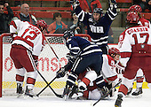 Colin Moore (Harvard - 12), Austin Block (UNH - 3), Danny Fick (Harvard - 7), Kevin Goumas (UNH - 27) - The Harvard University Crimson defeated the University of New Hampshire Wildcats 7-6 on Tuesday, November 22, 2011, at Bright Hockey Center in Cambridge, Massachusetts.