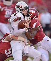 STAFF PHOTO BEN GOFF  @NWABenGoff -- 09/20/14 <br /> Arkansas linebackers Matrell Spaight, right, and Brooks Ellis tackle Northern Illinsois quarterback Drew Hare during the first quarter of the game in Reynolds Razorback Stadium in Fayetteville on Saturday September 20, 2014.