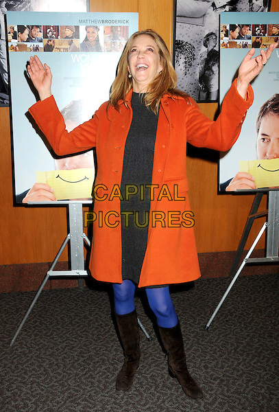 "ALLY WALKER .Attending ""Wonderful World"" Los Angeles Premiere held at the Director's Guild Theatre, West Hollywood, California, USA, 7th January 2010..full length coat sweater dress jumper black red orange hands gesture funny blue cobalt tights knee high boots grey gray .CAP/ADM/BP.©Byron Purvis/AdMedia/Capital Pictures."