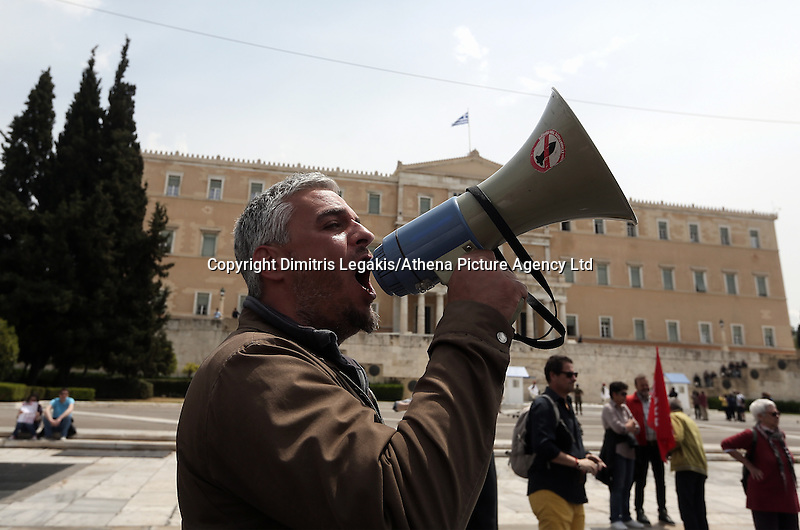 Pictured: A man with a megaphon in Syntagma Square Sunday 08 May 2016<br /> Re: Members of left wing parties gather outside the Greek Parliament, while MPs vote on pension and welfare reforms, Athens, Greece