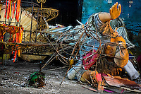 A discarded carnival sculpture abandoned on the work yard behind the Samba school workshops in Rio de Janeiro, Brazil, 13 February 2012. Most of the large carnival floats, colorful designs and fancy costumes are dismantled, cut into pieces or simply thrown into garbage right after the last day of the Carnival. The low-tech materials as fiberglass, plastic or polystyrene, which most of the of the carnival floats and statues are made of, are stocked in the warehouses to be recycled and used in the future parades. However, there is no use for some of the statues so they slowly fall apart into pieces forming a ?Carnival cemetery? in the industrial yards around the port of Rio de Janeiro.