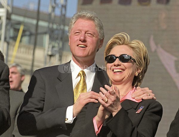 United States President Bill Clinton and first lady Hillary Rodham Clinton watch an elite military paratrooper show during the Opening Ceremonies of America's Millennium Celebration in Washington, D.C. on December 31, 1999.<br /> Credit: Ron Sachs / CNP/MediaPunch