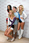 "Chanel Iman, Erin Heatherton, and  Candice Swanepoel pose with guest during the ""Incredible by Victoria's Secret"" launch at the Victoria Secret SOHO Store, August 10, 2010."