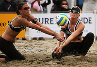 NZ's Anna Scarlett and Susan Blundell both converge on the ball during the 2009 McEntee Hire NZ Beach Volleyball Tour - Women's final at Oriental Parade, Wellington, New Zealand on Sunday, 11 January 2009. Photo: Dave Lintott / lintottphoto.co.nz.
