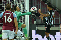 Callum Wilson of Newcastle United gets his foot a head of Lukasz Fabianski of West Ham United to scores the first Goal and celebrates during West Ham United vs Newcastle United, Premier League Football at The London Stadium on 12th September 2020