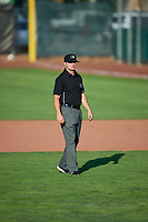 Umpire Jake Bruner handles the calls on the bases during the Pioneer League game between the Orem Owlz and the Ogden Raptors at Lindquist Field on June 21, 2017 in Ogden, Utah. The Owlz defeated the Raptors 16-5. This was Opening Night at home for the Raptors.  (Stephen Smith/Four Seam Images)