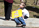 Carter Terreault, 7, of Enfield, with a caring touch on the head from his mom Christine, after marching to Enfield High from the town green, during the an anti-gun rally, Saturday, March 24, 2018, in Enfield. (Jim Michaud / Journal Inquirer)