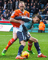 Paris Cowan-Hall of Wycombe Wanderers holds off Jake Howells of Luton Town during the Sky Bet League 2 match between Wycombe Wanderers and Luton Town at Adams Park, High Wycombe, England on 6 February 2016. Photo by Massimo Martino.