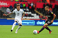 Joe Rodon of Swansea City vies for possession with George Pușcaș of Reading during the Sky Bet Championship match between Swansea City and Reading at the Liberty Stadium, Swansea, Wales, UK. Saturday 28 September 2019