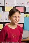 Elementary school Grade 5 closeup portrait of girl vertical