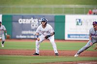 Northwest Arkansas Naturals infielder Emmanuel Rivera (26) takes a lead off first on May 6, 2019, at Arvest Ballpark in Springdale, Arkansas. (Jason Ivester/Four Seam Images)