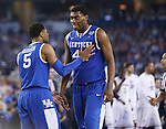 UK guard Andrew Harrison (5) talks to UK center Dakari Johnson (44) during the NCAA Championship vs. UConn at the AT&T Stadium in Arlington, Tx., on Monday, April 7, 2014. Photo by Emily Wuetcher | Staff