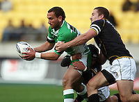 Wellington's Scott Fuglistaller and Dan Kirkpatrick tackle Aaron Cruden. Air NZ Cup - Wellington Lions v Manawatu Turbos at Westpac Stadium, Wellington, New Zealand. Saturday 3 October 2009. Photo: Dave Lintott / lintottphoto.co.nz