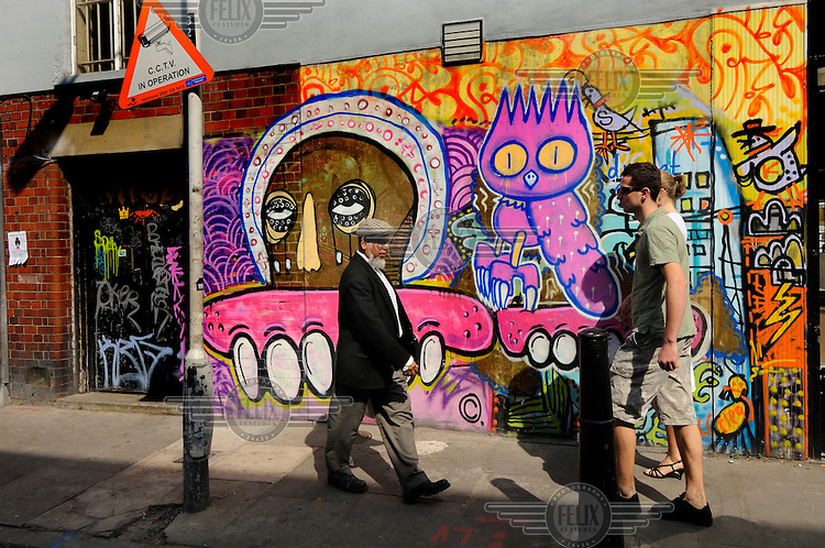 Colourful graffiti on London's Brick Lane, heart of the city's Bangladeshi community.