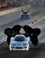 Nov. 1, 2008; Las Vegas, NV, USA: NHRA funny car driver Gary Scelzi slows down after his run during qualifying for the Las Vegas Nationals at The Strip in Las Vegas. Mandatory Credit: Mark J. Rebilas-