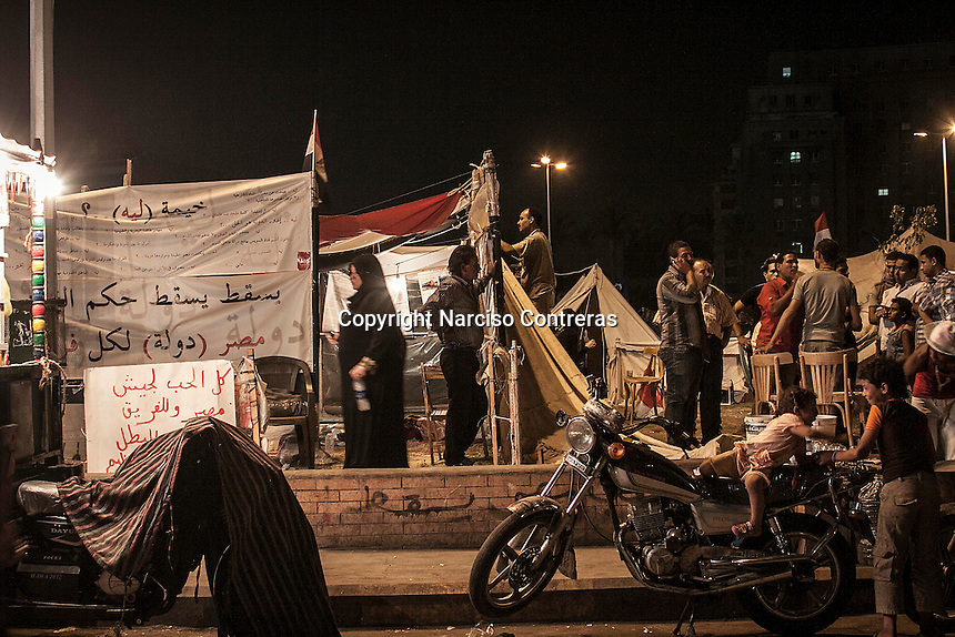 In this Saturday, Jul. 06, 2013 photo, opponents to the ousted president Mohammed Morsi are seen in Tahrir Square in Cairo, Egypt. (Photo/Narciso Contreras).