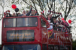 Fans arriving on a double-decker bus at Broadhurst Park, Manchester, the new home of FC United of Manchester before the club's match against Benfica, champions of Portugal, which marked the official opening of their new stadium. FC United Manchester were formed in 2005 by fans disillusioned by the takeover of Manchester United by the Glazer family from America. The club gained several promotions and played in National League North in the 2015-16 season, but lost this match 1-0.