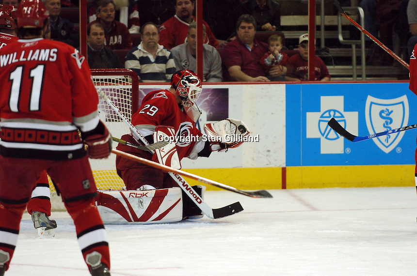 Carolina Hurricanes' goaltender Martin Gerber of Switzerland makes a save against the New York Rangers Tuesday, March 14, 2006 at the RBC Center in Raleigh, NC. Carolina won 5-3.
