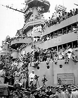Spectators and photographers pick vantage spots on the deck of the USS MISSOURI in Tokyo Bay, to witness the formal Japanese surrender proceedings.  September 2, 1945. (Army)<br /> NARA FILE #:  111-SC-210644<br /> WAR &amp; CONFLICT BOOK #:  1361