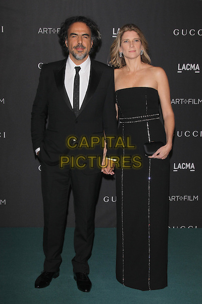 LOS ANGELES, CA - NOVEMBER 7: Alejandro Gonzalez Inarritu and Maria Eladia Hagerman at the LACMA Art + Film Gala honoring Alejandro G. I&ntilde;&aacute;rritu and James Turrell and presented by Gucci at LACMA on November 7, 2015 in Los Angeles, California. <br /> CAP/MPI27<br /> &copy;MPI27/Capital Pictures