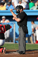 Home plate umpire Tyler Curlis makes a call during a game between the Batavia Muckdogs and Staten Island Yankees at Dwyer Stadium on July 29, 2011 in Batavia, New York.  Staten Island defeated Batavia 10-7.  (Mike Janes/Four Seam Images)