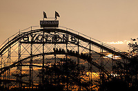 The sun set on the Coney Island Cyclone roller coster on Coney Island in New York city borough of Brooklyn, Sunday July 31, 2011. A New York City landmark, The Coney Island Cyclone (better known as simply the Cyclone) is a historic hybrid roller coaster build in 1927.