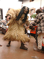 ZUBIETA, NAVARRE - JANUARY 31: A disguised man with furs of animal during the celebration of an ancient traditional carnival in Zubieta on January 31, 2006. Photo by Ander Gillenea