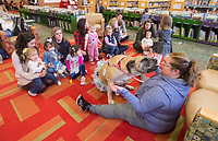 NWA Democrat-Gazette/BEN GOFF @NWABENGOFF<br /> Tricia Jennings and Zaida, a trained therapy dog, sit down for a program Saturday, Jan. 5, 2019, at the Bentonville Public Library. Zaida, with handler Tricia Jennings of Gravette, is one of three therapy dogs that alternates visits to the library for Saturday morning reading programs. The programs encourage children to develop reading skills by reading aloud ot the therapy dogs.