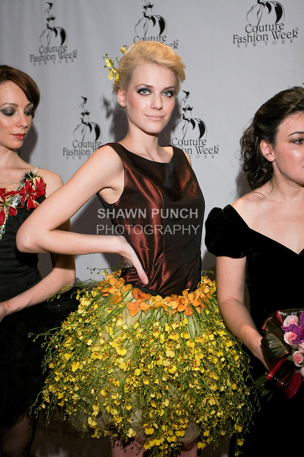 """Jaqueline Backer poses on the red carpet after the Alaric Design Floral Concept Dress """"Arrangement Collection"""" fashion show, during Couture Fashion Week Fall 2011."""