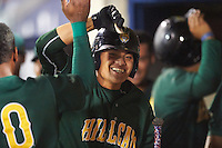 Lynchburg Hillcats shortstop Yu-Cheng Chang (6) is congratulated by teammates in the dugout after hitting a home run during a game against the Wilmington Blue Rocks on June 3, 2016 at Judy Johnson Field at Daniel S. Frawley Stadium in Wilmington, Delaware.  Lynchburg defeated Wilmington 16-11 in ten innings.  (Mike Janes/Four Seam Images)