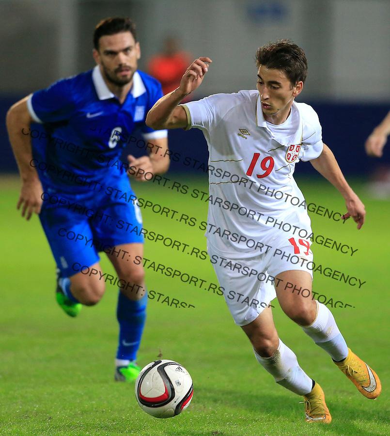 Fudbal<br /> Prijateljski mec-Friendly match<br /> Srbija v Grcka<br /> Filip Djuricic (R) and Alexandros Tziolis<br /> Chania, 18.11.2014.<br /> foto: Srdjan Stevanovic/Starsportphoto &copy;