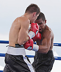 Jason Escalera from Union City, NJ, right, fights Norbert Nemesapati from Budapest, Hungary during the Super Middleweight bout Rural Rumble on Friday night, August 8, 2014 at Churchill County Fairgrounds in Fallon, Nevada.