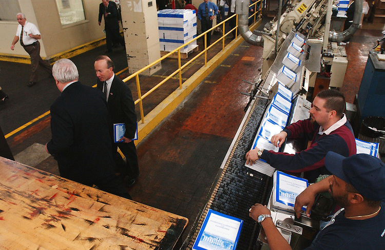 1/29/03.2004 FEDERAL BUDGET--Office of Management and Budget Director Mitchell E. Daniels Jr., and Public Printer of the United States Bruce R. James, white hair, leave a photo opp as copies of the Bush administration's Fiscal 2004 federal budget come off the binder at the U.S. Government Printing Office in Washington, D.C. The budget, which will be released Feb. 3, is 2,912 pages long and includes five volumes: Budget of the U.S. Government; Budget Appendix; Analytical Perspectives; Historical Tables; and Performance and Management Assessment. It will also be available on CD-ROM..CONGRESSIONAL QUARTERLY PHOTO BY SCOTT J. FERRELL